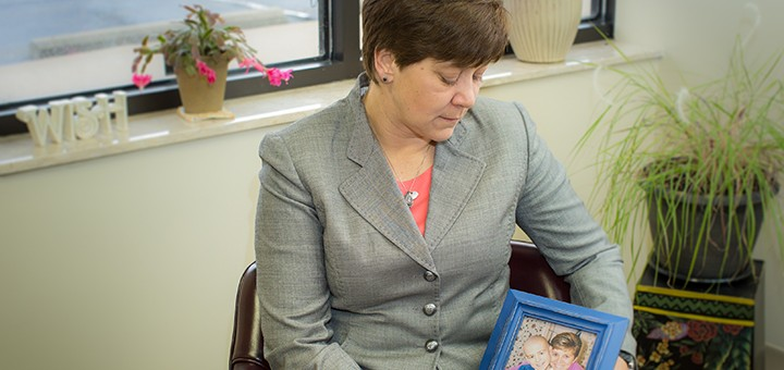 Pam Frenzel holds a photo of her son Tyler. (Photo by Sara Crawford)