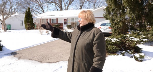 Mary Eckard points to Johnson Addition homes, which she and others say needs to be preserved. (Photo by Theresa Skutt)